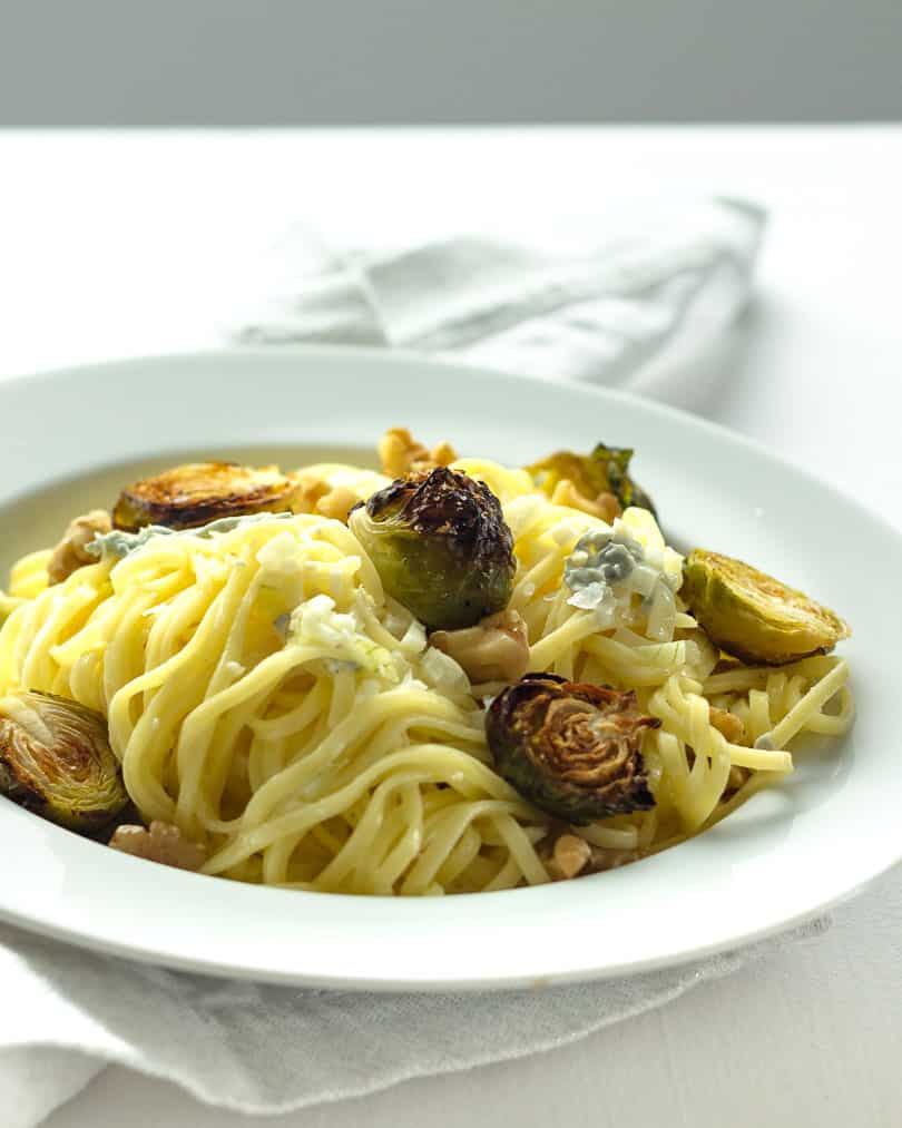 Pasta with brussels sprouts and blue cheese in front of window