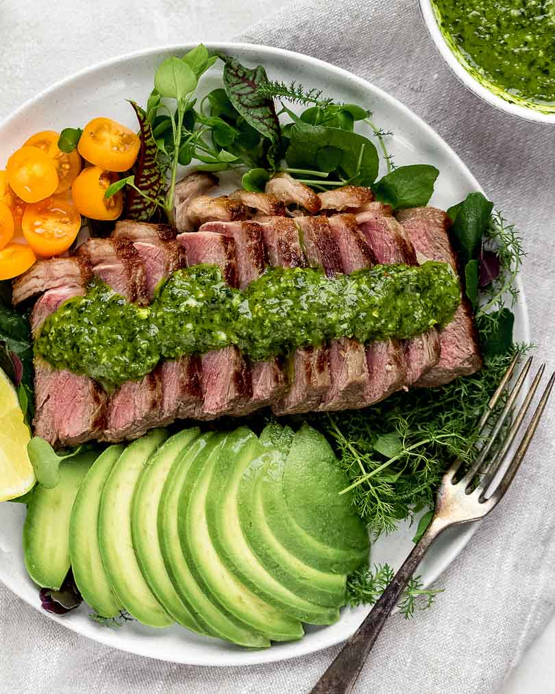 Steak Salad with chimichurri and avocados on plate