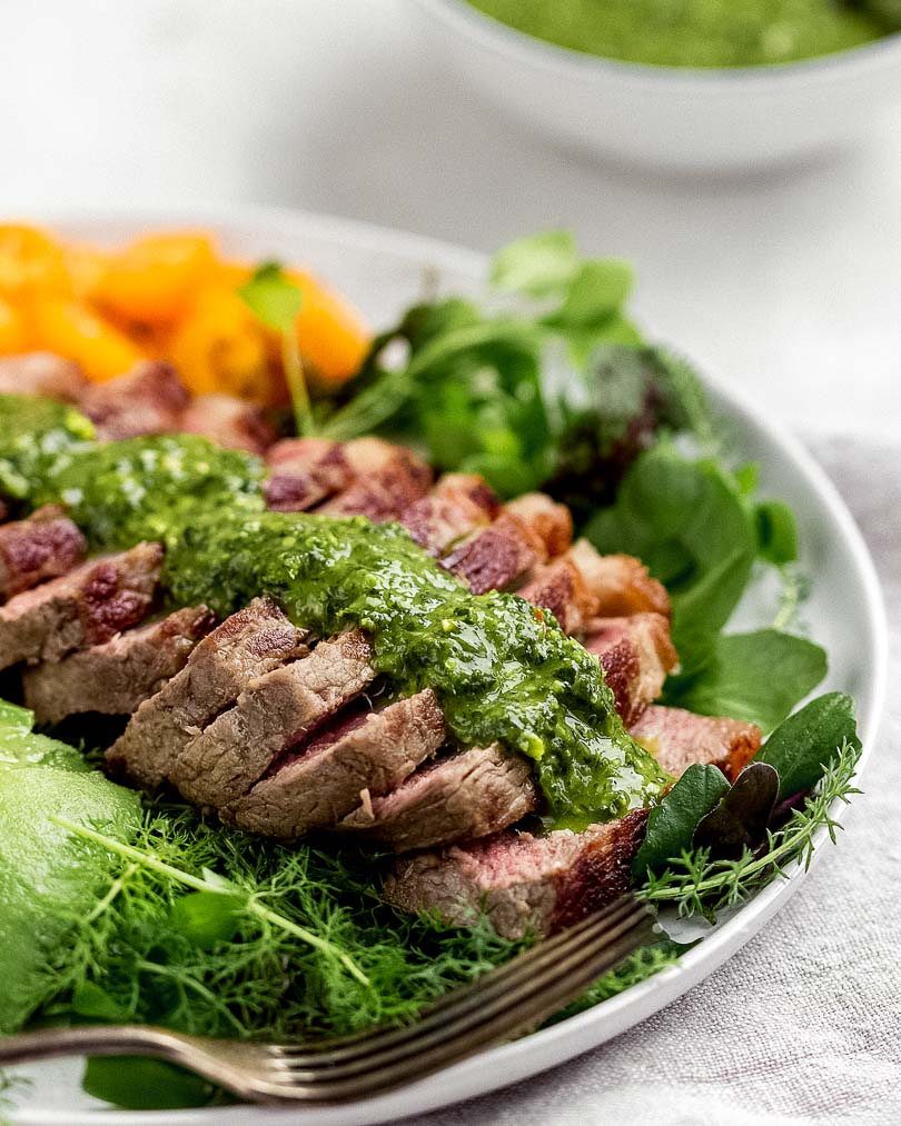 Steak salad with chimichurri and avodado from the side