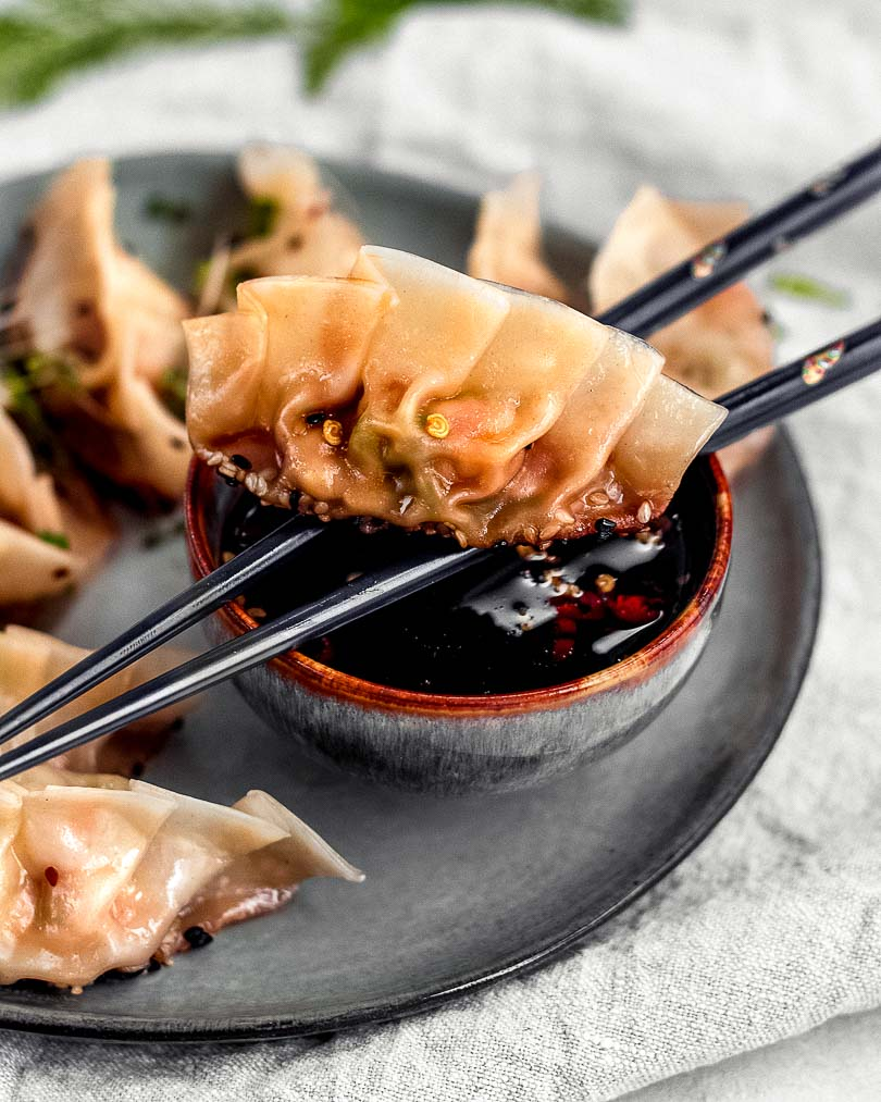 Chicken potstickers with soy honey chili sauce on plate