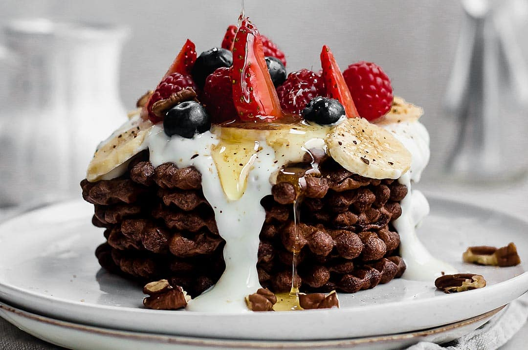 Chocolate waffles with yogurt and fresh berries